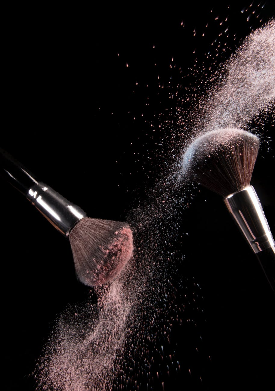 cosmetics makeup brushes and powder dust explosion