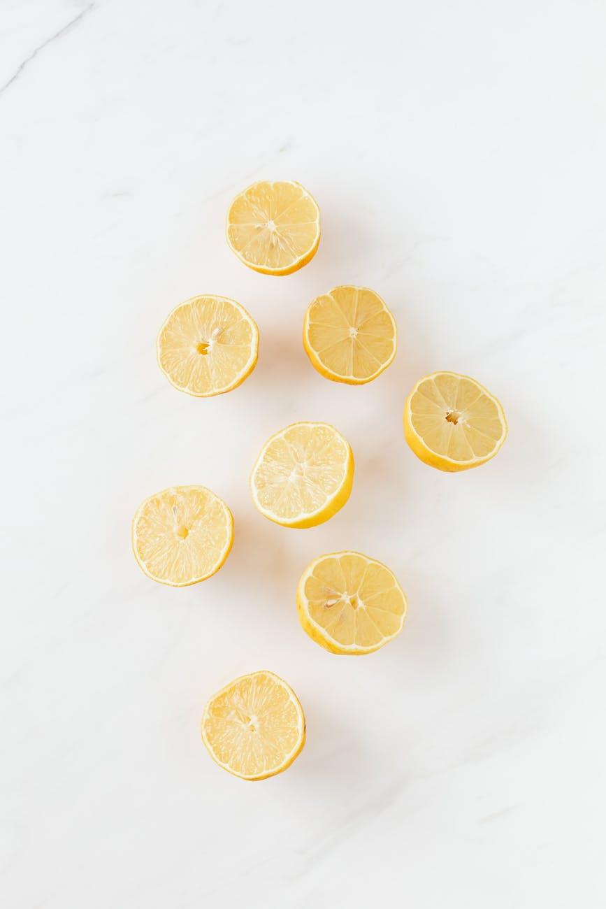 abstract halved tasty ripe lemons on white surface