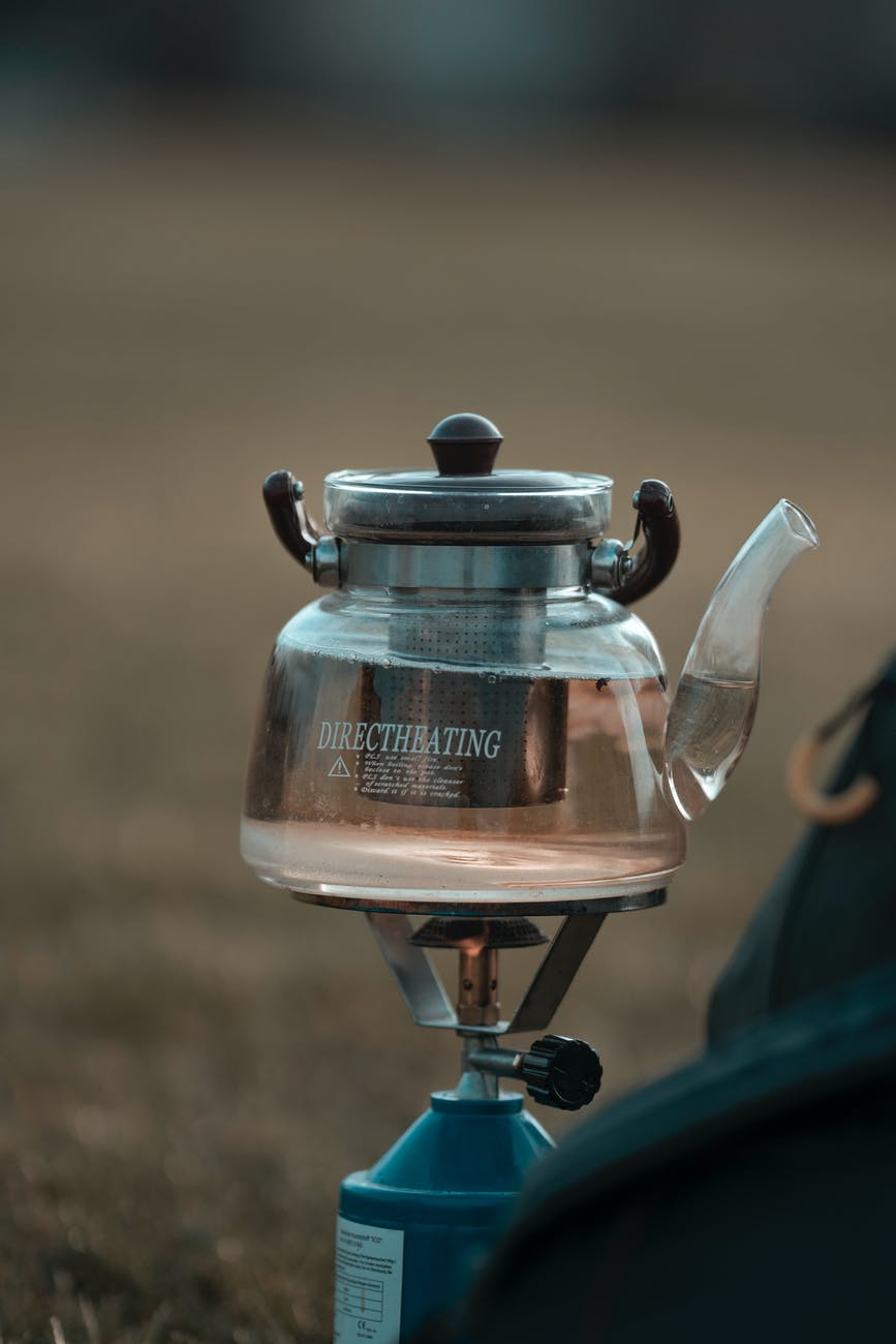 glass kettle on gas burner in nature